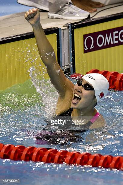 Shen Duo of China celebrates after winning the Mixed 4 x 100m Freestyle Relay final match on day one of the Nanjing 2014 Summer Youth Olympic Games...