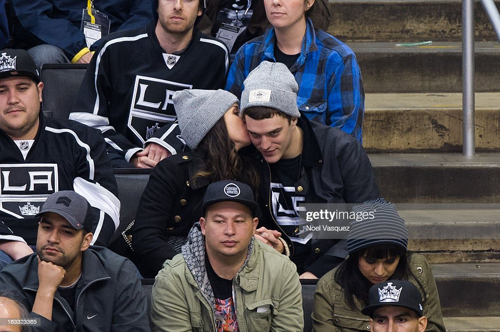 Shenae Grimes (L) and Josh Beech attend a hockey game between the Dallas Stars and Los Angeles Kings at Staples Center on March 7, 2013 in Los Angeles, California.