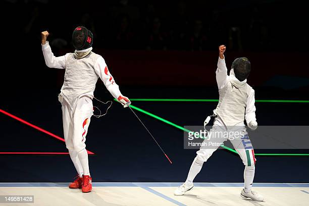Sheng Lei of China and Andrea Baldini of Italy claim a point in their Men's Foil Individual Semifinal against on Day 4 of the London 2012 Olympic...