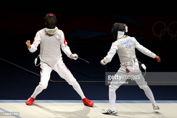 Sheng Lei of China celebrates a point in his Men's Foil Individual Semifinal against Andrea Baldini of Italy on Day 4 of the London 2012 Olympic...