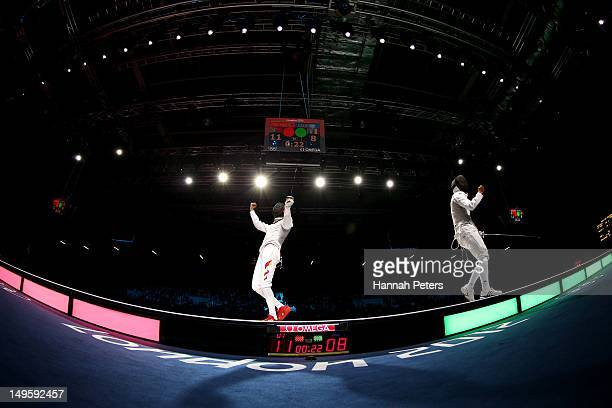 Sheng Lei of China celebrates winning his Men's Foil Individual Semifinal against Andrea Baldini of Italy on Day 4 of the London 2012 Olympic Games...