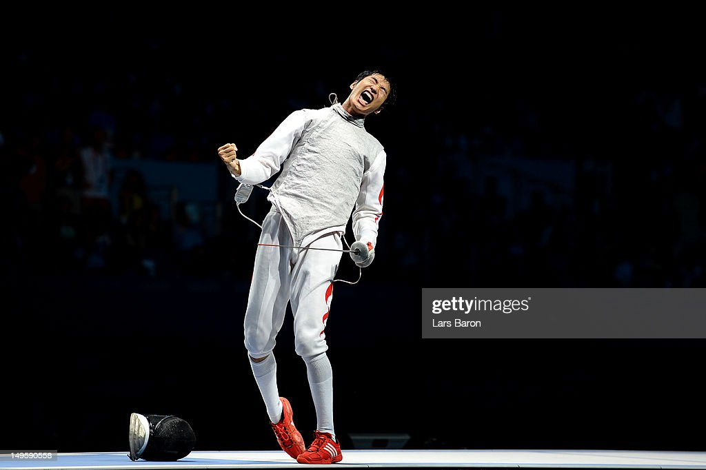 Sheng Lei of China celebrates winning the Men's Foil Individual Gold Medal Bout against Alaaeldin Abouelkassem of Egypt on Day 4 of the London 2012 Olympic Games at ExCeL on July 31, 2012 in London, England.