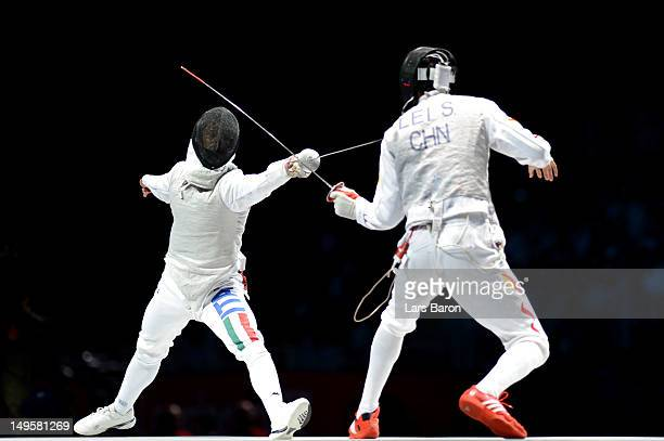 Sheng Lei of China competes against Andrea Baldini of Italy in his Men's Foil Individual Semifinal against on Day 4 of the London 2012 Olympic Games...