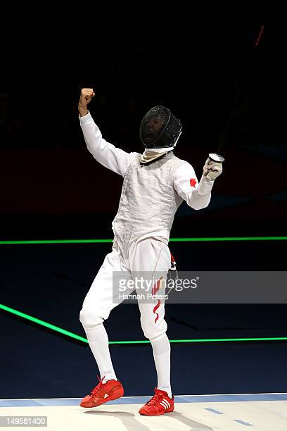 Sheng Lei of China winning his Men's Foil Individual Semifinal against Andrea Baldini of Italy on Day 4 of the London 2012 Olympic Games at ExCeL on...