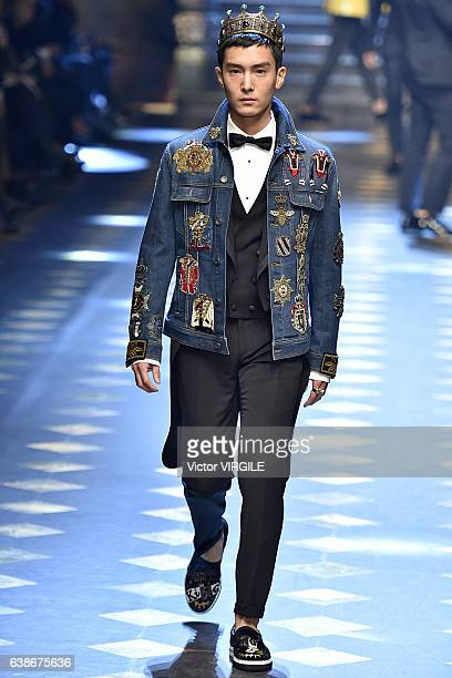 Sheng Yilun walks the runway at the Dolce Gabbana show during Milan Men's Fashion Week Fall/Winter 2017/18 on January 14 2017 in Milan Italy