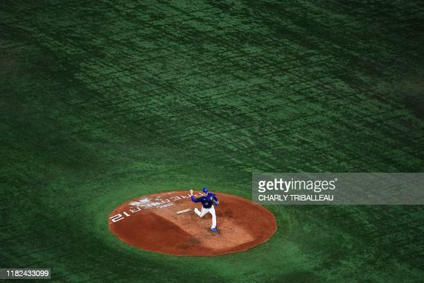 Sheng-Feng Wu of Taiwan throws the ball during the WBSC Premier 12 Super Round baseball match between the US and Taiwan, at the Tokyo Dome in Tokyo...