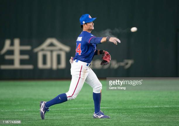 ShengWei Wang of Chinese Taipei defense during the WBSC Premier 12 Super Round game between USA and Chinese Taipei at the Tokyo Dome on November 15...