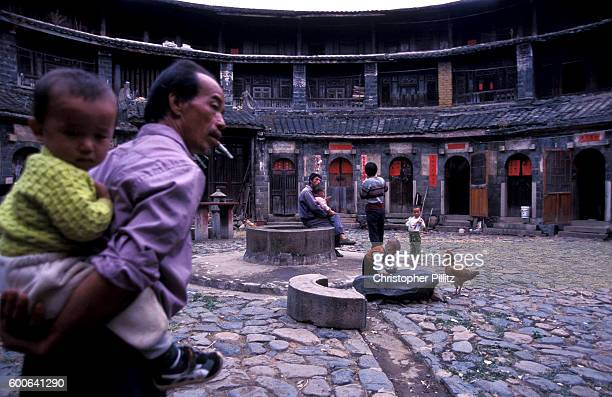 Shengwu Lou round earth dwelling in the village of Jiaolu, Fujian Province. Interior circular courtyard and living spaces with central water well,...