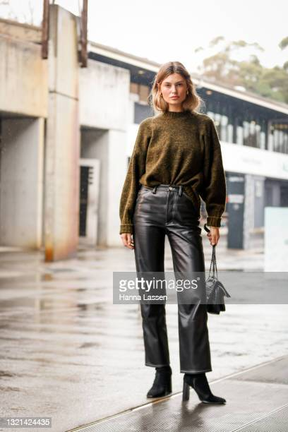 Shenise Breslin wering Camilla and Marc jumper, YSL black bag, Ducie London jeans and Tony Bianco boots at Afterpay Australian Fashion Week 2021 on...