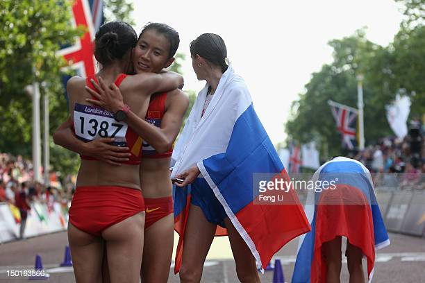 Shenjie Qieyang celebrates her bronze with Liu Hong of China after the Women's 20km Walk on Day 15 of the London 2012 Olympic Games on the streets of...