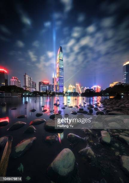 shenzhen, china. skyline reflection at night. - shenzhen stock pictures, royalty-free photos & images