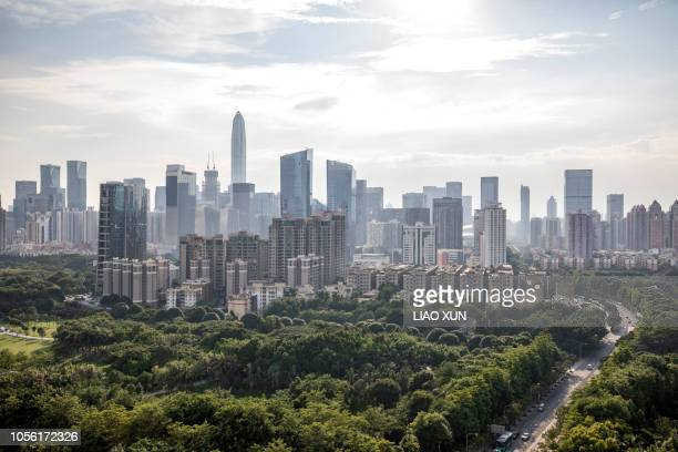 shenzhen skyline backlighting - shenzhen stock pictures, royalty-free photos & images