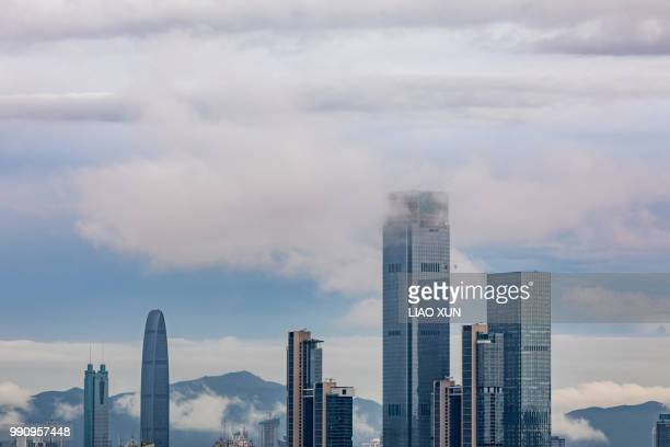 Shenzhen Skyscrapers in a low cloud weather