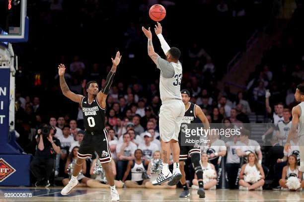 Shep Garner of the Penn State Nittany Lions takes a shot against Nick Weatherspoon of the Mississippi State Bulldogs in the third quarter during...
