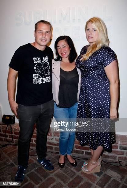 Shepard Fairey Amanda Fairey and Amanda de Cadenet attend opening night of #girlgaze Uncensored at Subliminal Projects Gallery on September 29 2017...
