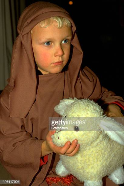 Shepherd age 7 holding stuffed lamb at Christmas pageant