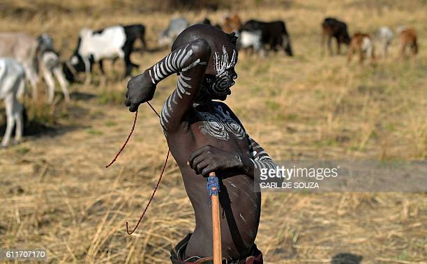 A shepherd boy from the Mursi tribe in Ethiopia's southern Omo Valley region near Jinka on September 22 2016 The Mursi are a Nilotic pastoralist...