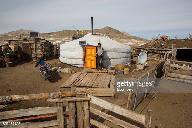 A shepherd exits his ger in Murun Khovsgol Province Mongolia on Friday March 10 2017 Mongolia's gross domestic product is expected to expand eight...