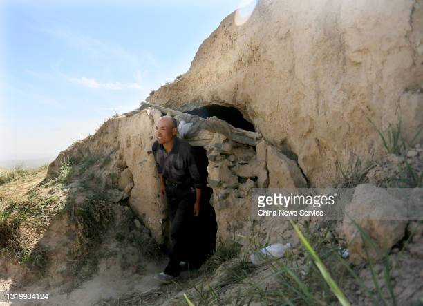 Shepherd Zhu Keming speaks to the media in a cave, where he saved the lives of six runners during a mountain ultramarathon on last Saturday, on May...