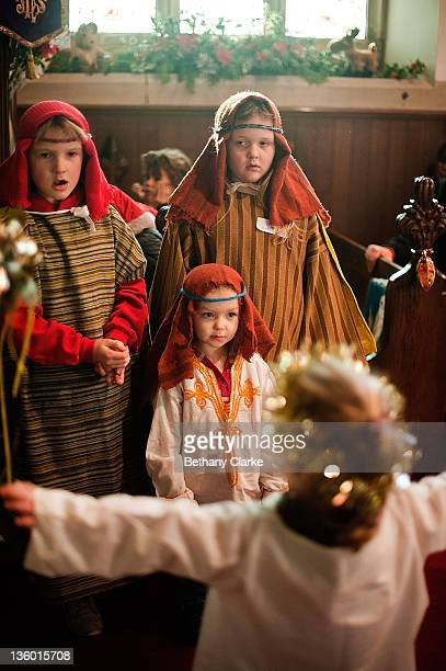 Shepherds are greeted by an angel during a traditional Christmas Nativity on December 18 at St Mary's Church Myton Village England In schools and...