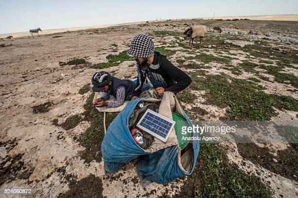 Shepherds charge their phones with solar panels carried by donkeys in Turkey's Sanliurfa on April 25 2016 Shepherds spend most of their times at...