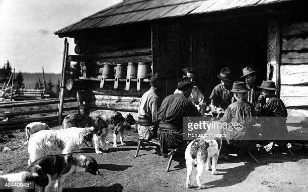 Shepherds taking a break for lunch, Bistrita Valley, Moldavia, north-east Romania, c1920-c1945. Depicting customs and traditional labour in the rural...