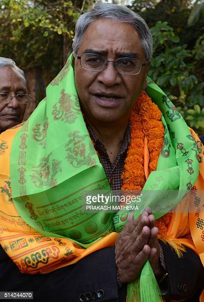 Sher Bahadur Deuba the newly elected president of Nepali Congress is congratulated by supporters at his residence in Kathmandu on March 8 2016 Former...