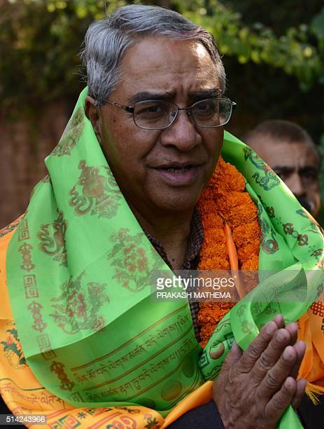 Sher Bahadur Deuba the newly elected president of Nepali Congress greets supporters at his residence in Kathmandu on March 8 2016 Former prime...