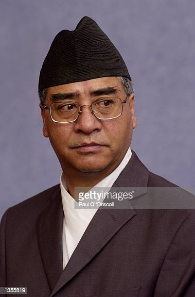 M Sher Bahadur Deuba the Prime Minister of Nepal arrives for a meeting August 27 2002 in Brussels Belgium Deuba received a promise from the EU of 50...