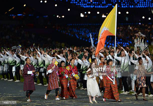 Sherab Zam of the Bhutan Olympic archery team carries her country's flag during the Opening Ceremony of the London 2012 Olympic Games at the Olympic...