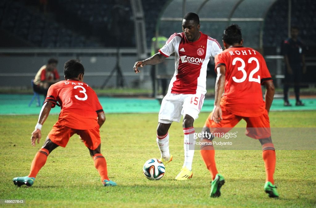 Sheraldo Becker of AFC Ajax (C) battles for the ball during the international friendly match between Perija Jakarta and AFC Ajax on May 11, 2014 in Jakarta, Indonesia. AFC Ajax win the game with score 3-0.