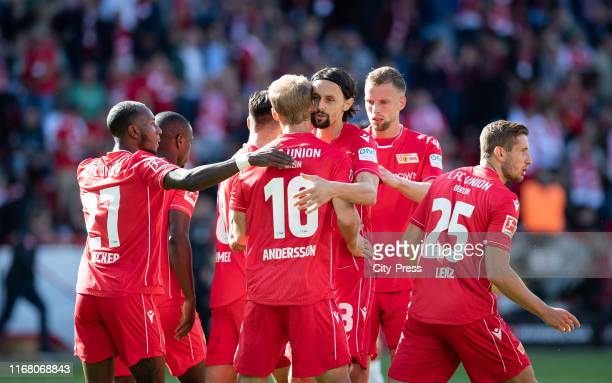 Sheraldo Becker Sebastian Andersson Neven Subotic Marvin Friedrich and Christopher Lenz of 1 FC Union Berlin celebrate after scoring the 11 during...