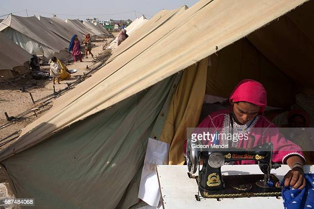 Sherbano operates her foot powered sewing machine in the Pakistan Navy Flood Relief Camp in Thatta She sews for her family and earns some income...