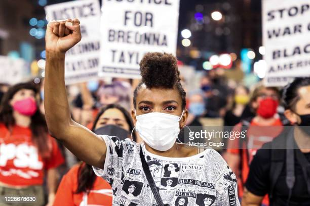 Sheree Barbour holds her fist in the air as people protest the grand jury decision in the Breonna Taylor case on September 23 2020 in Denver United...