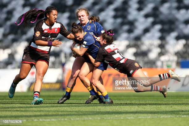 Sheree Hume of Otago is tackled by Larissa Lima of Counties Manukau during the round four Farah Palmer Cup match between Otago and Counties Manukau...