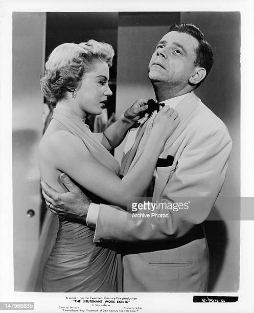 Sheree North tightening Tom Ewell's tie in a scene from the film 'The Lieutenant Wore Skirts' 1956