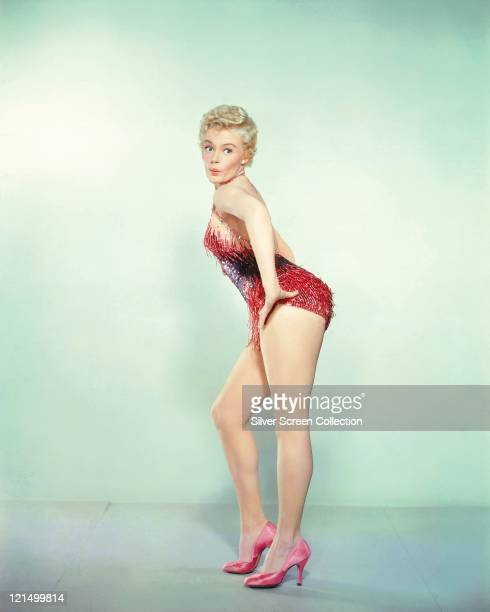 Sheree North US actress singer and dancer wearing a showgirl costume in a studio portrait circa 1955