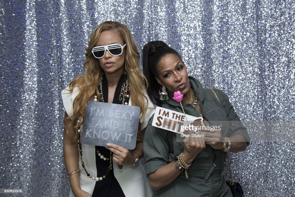 Sheree Whitfield (R) and Gizelle Bryant (L) attend 'Cupcakes With Sheree DC' Meet & Greet Affair and book signing for 'Wives, Fiancees and Side-Chicks of Hotlanta' at Stonefish Grill on August 11, 2017 in Washington, DC.
