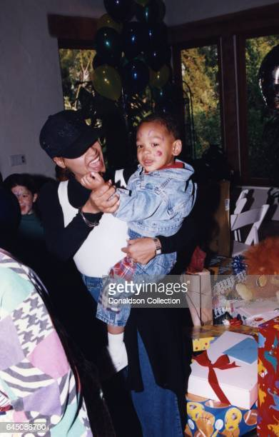 Sheree Zampino holds her son Trey Smith at his second birthday party on November 14, 1992 in Los Angeles, California .