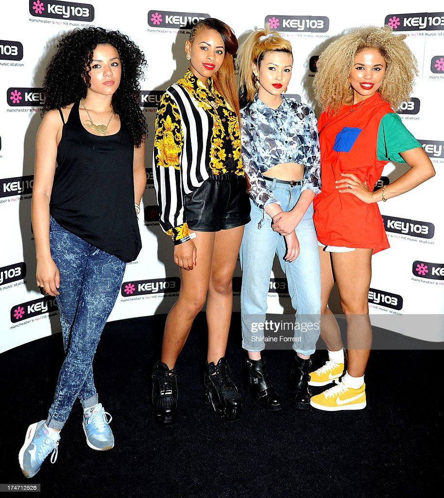 Shereen Cutkelvin, Amira McCarthy, Asami Zdrenka and Jessica Plummer of Neon Jungle pose backstage at Key 103 Live at Manchester Arena on July 28, 2013 in Manchester, England.