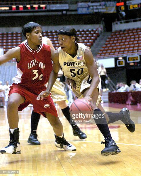 Shereka Wright drives around Christin Black in the first half of Purdue's 78-59 win.