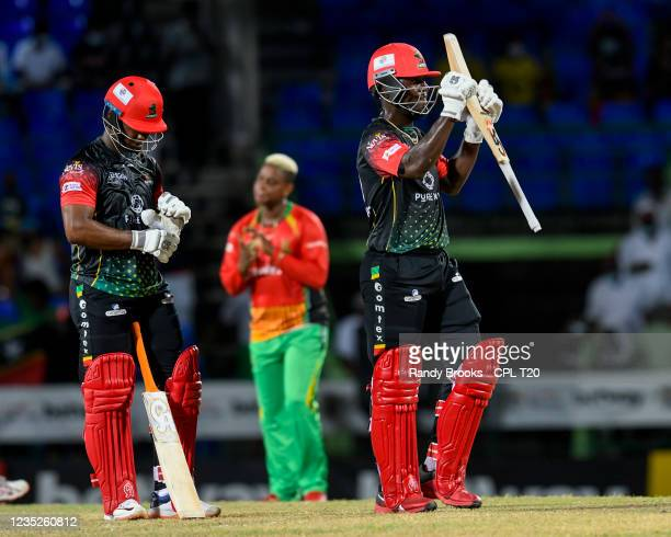 Sherfane Rutherford and Evin Lewis of Saint Kitts & Nevis Patriots celebrate winning the 2021 Hero Caribbean Premier League Play-Off match 32 between...