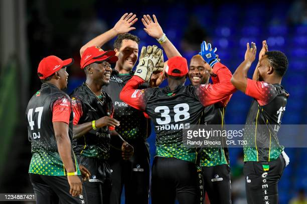 Sherfane Rutherford , Paul van Meekeren and Fabian Allen of St. Kitts & Nevis Patriots celebrate the dismissal of Johnson Charles of Barbados Royals...