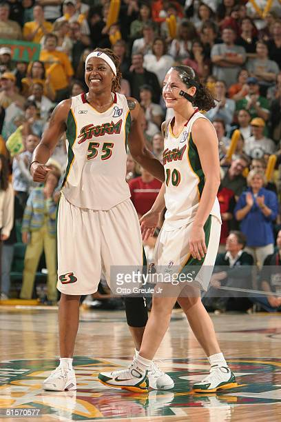 Sheri Sam and Sue Bird of the Seattle Storm celebrate in Game three of the WNBA Finals against the Connecticut Sun at Key Arena on October 12 2004 in...