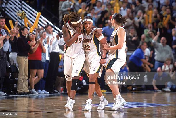 ?Sheri Sam, Betty Lennox, and Tully Bevilaqua of the Seattle Storm congratulate each other as they celebrate their win against the Connecticut Sun in...