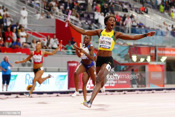 Shericka Jackson of Jamaica gold crosses the finish line in the Women's 4x100 Metres Relay during day nine of 17th IAAF World Athletics Championships...