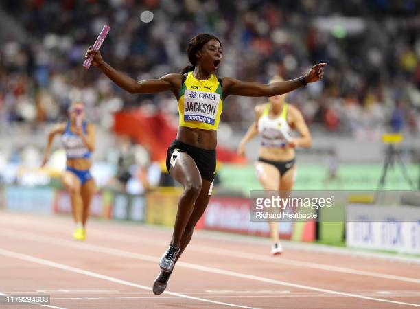 Shericka Jackson of Jamaica, gold, crosses the finish line in the Women's 4x100 Metres Relay final during day nine of 17th IAAF World Athletics...