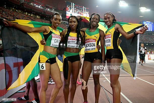 Shericka Jackson of Jamaica Stephenie Ann McPherson of Jamaica Novlene WilliamsMills of Jamaica and Christine Day of Jamaica celebrate after winning...