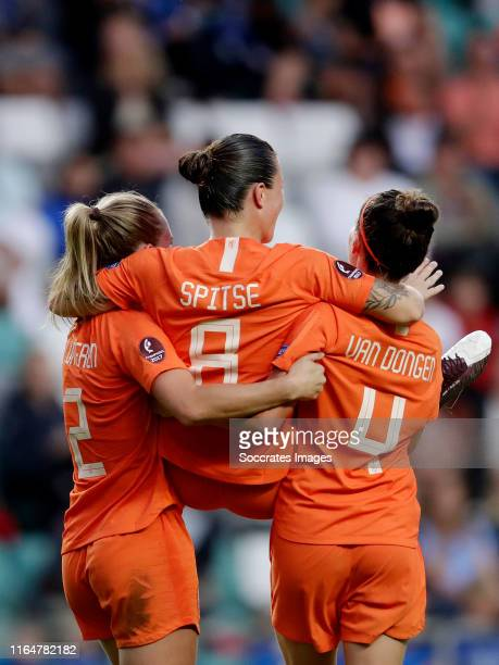 Sherida Spitse of Holland celebrates 04 with Desiree van Lunteren of Holland Merel van Dongen of Holland during the EURO Qualifier Women match...