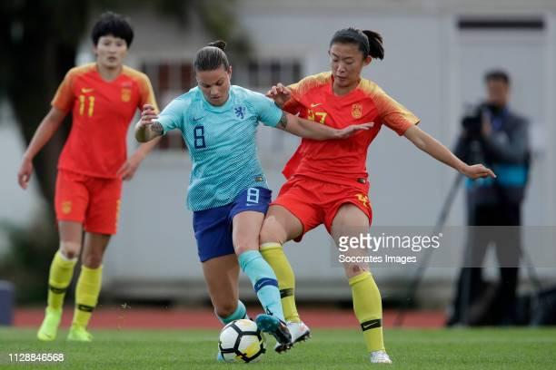 Sherida Spitse of Holland Women, Yao Wei of China Women during the Algarve Cup Women match between China PR v Holland at the Estadio Municipal de...